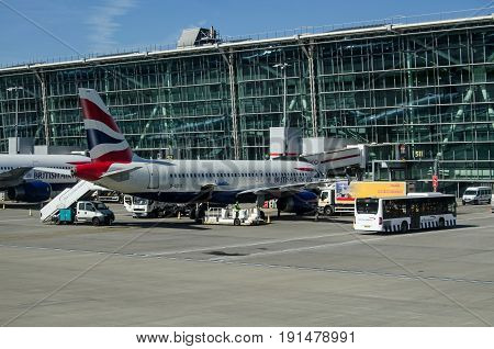 LONDON UK - JUNE 3 2017: A British Airways airbus A320 at a stand at Terminal 5 of Heathrow Airport on a sunny morning in early summer.