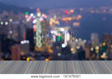 Opening wooden floor Blurred bokeh light Hong Kong city busienss downtown abstract background