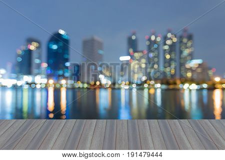 Opening wooden floor Blue twilight over office building with reflection night view abstract background