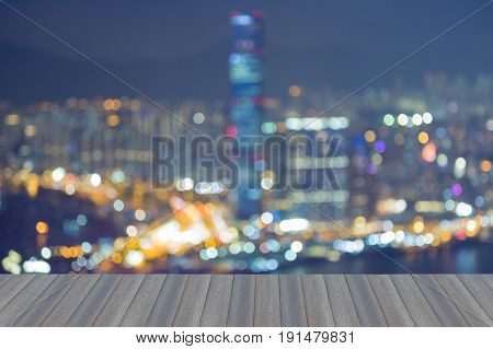Opening wooden floor Abstract blurred bokeh Hong Kong city downtown light night view