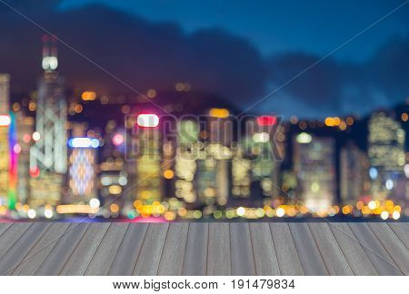 Opening wooden floor Night twilight blurred bokeh Hong Kong city downtown office building abstract background
