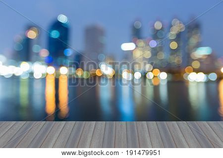 Opening wooden floor Night blurred bokeh blue twilight office building and reflection abstract background
