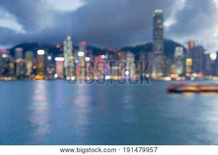 Blue twilight sky blurred bokeh light Hong Kong cityscape downtown waterfront abstract background