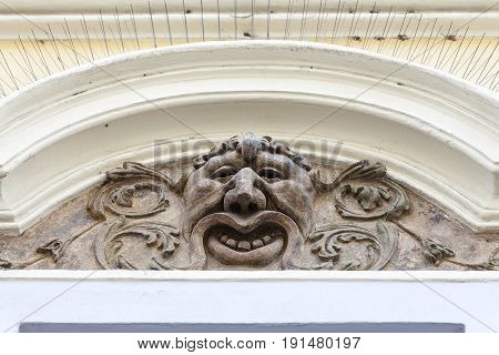 Relief on facade of old building mascaron ornament Prague Czech Republic Europe