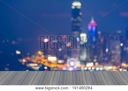 Opening wooden floor Blue twilight Hong Kong city blurred bokeh light downtown abstract background