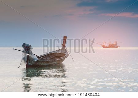 Small fishing boat abandon in ocean skyline natural landscape background