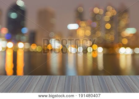 Opening wooden floor City blurred bokeh light with water reflection abstract background