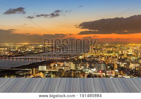 Opening wooden floor Dramatic after sunset sky over Osaka cityscape aerial view Japan