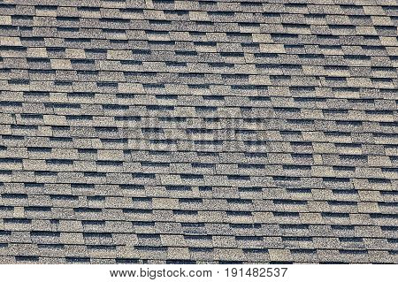 Gray black tile on the roof of a private building
