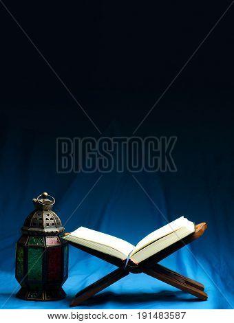 Quran or Kuran the islamic holy book in dark background