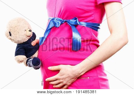 Pregnant Woman In Dress With Ribbon Holding Teddy Bear At Her Belly, Toy For Kids