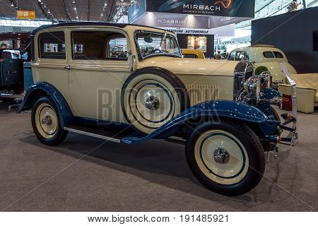 STUTTGART GERMANY - MARCH 02 2017: Small car Opel 1.2 litre 1934. Europe's greatest classic car exhibition