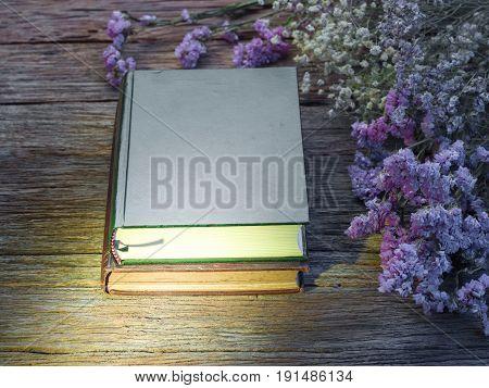 Quran or Kuran the islamic holy book in dark wooden background