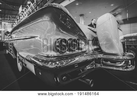 STUTTGART GERMANY - MARCH 02 2017: Fragment of the full-size car Chevrolet Impala convertible 1958. Stylization. Black and white. Europe's greatest classic car exhibition