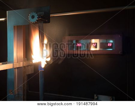 vertical burning test in second stage in progress of physical property of polymer substance in standard laboratory or flamability of materials to classified of V0 V1 or V2.