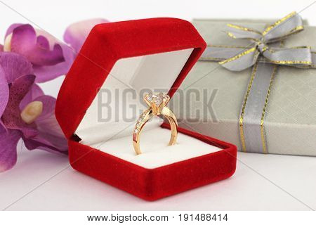 ring in jewelry box , flower background