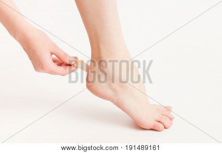 Sticking A Patch On The Foot Of The Foot On White