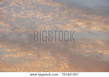 Sundown and sunrises. Orange sky and much clouds. Beautiful bright heaven