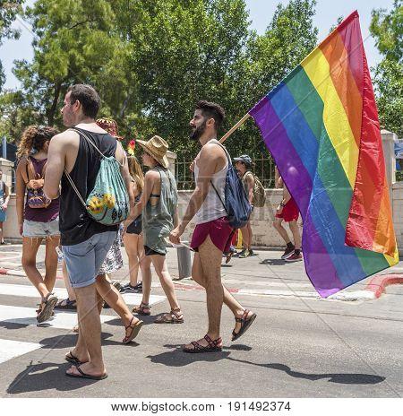 Tel Aviv, Israel - June 2017: participants with LBGT flag at annual gay pride parade