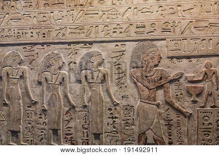 Some Egyptian Hieroglyphics on a Stone Wall