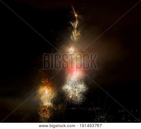 Photo of wonderful fireworks on dark sky