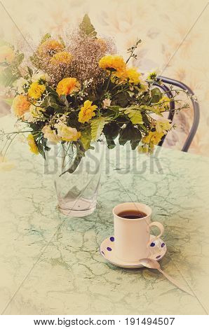 Tea Cup And Bouquet