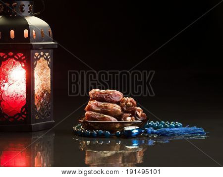 dates sweet dried fruits on dark background vegetable for diet with nutrition ingredient concept. Arabic text means