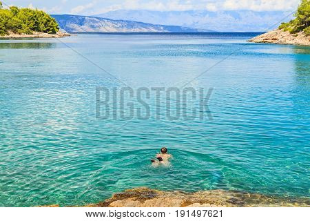 Young woman swimming in the mediterranean sea