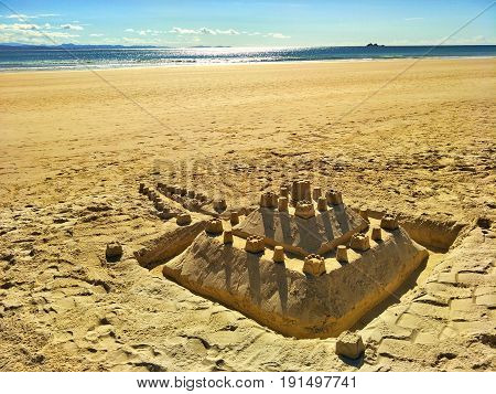 Sandcastle at Byron bay beach with beautiful background.