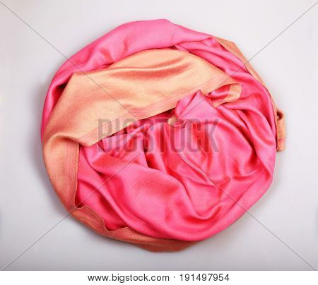 Beige and pink cashmere scarf on white background scarf ,top view. Selective focus