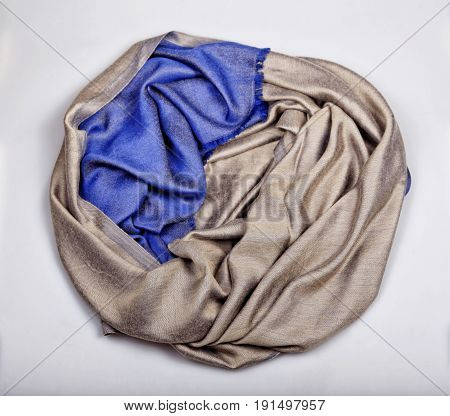Beige and blue cashmere scarf on white background scarf, top view. Selective focus