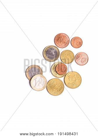 Many Euro coins are isolated on white background