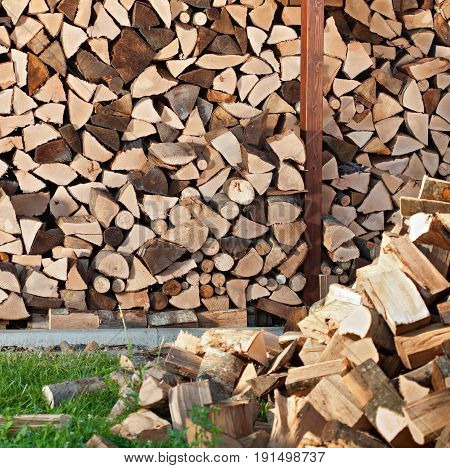 Firewood in a heap and arranged in stacks