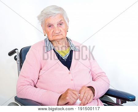 Photo of lonely elderly woman in wheelchair