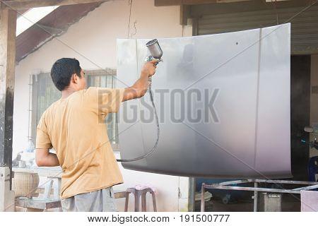 Worker Painting Grey Bonnet