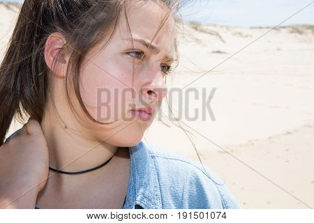 a sad girl in summer beach vacation