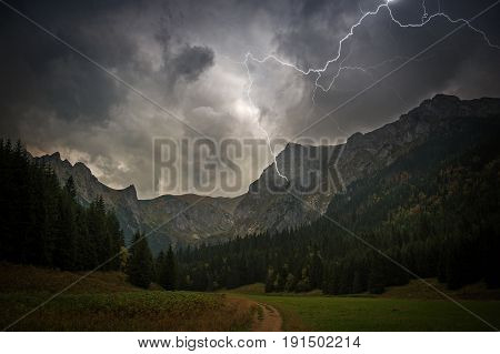 High Mountains Electric Storm Scenery. Stormy and Dangerous Mountain Trail.