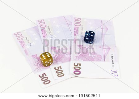 500 Euro bank notes and dices on a white background. Concept of gambling came