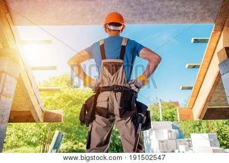 New House Building Project. Construction Contractor Worker in the Middle of Future Balcony Entrance Preparing For the Next Move. Home Builder.