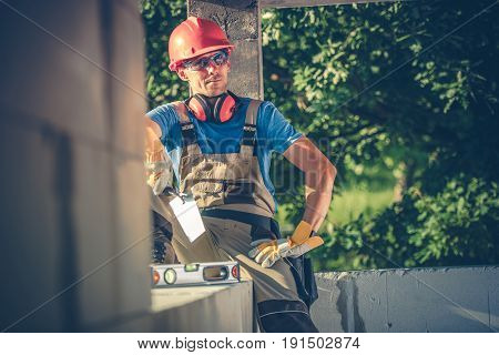 Satisfied Caucasian Contractor Worker. Construction Site Workplace. Men Taking Lunch Break.