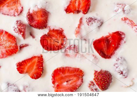 Yoghurt with strawberries. top view. background or texture