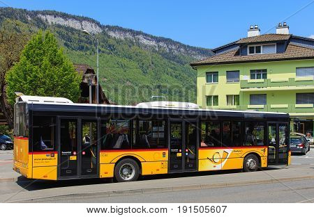 Stans, Switzerland - 7 May, 2016: a Solaris Urbino 12 bus of the PostAuto. PostAuto is a subsidiary company of the Swiss Post, it provides regional and rural bus services throughout Switzerland and also in France and Liechtenstein.