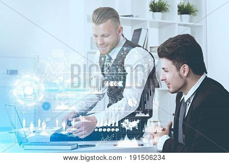 Close up of a young bearded businessman in a suit and his dark haired colleague sitting in a white office and working. Toned image double exposure