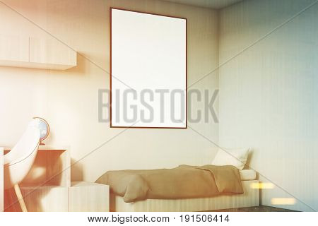 Corner of a kids room interior with a poster hanging above a bed bookshelves and a blue chair. White walls. 3d rendering mock up toned image