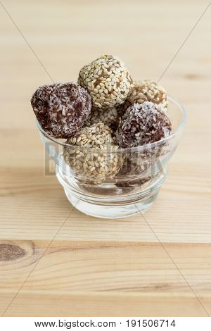 Homemade healthy paleo dates and chocolate energy balls. Vegan truffles. Copy space. Soft toned photo