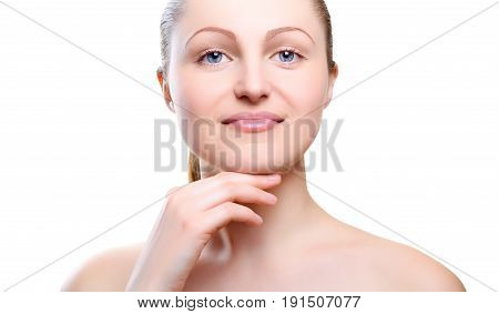 Portrait of girl with nude make-up with hands on chin isolated on white background. Girl with clean healthy skin on white. Cosmetology medicine beauty care. Nude makeup