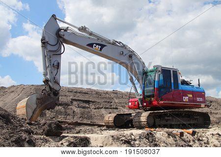 Naarden, The Netherlands - June 7, 2015: Caterpillar (CAT) 323D Crawler excavator on a construction site in the city of Naarden.