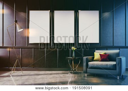 Gray living room interior with a poster gallery on the wall. There is a gray armchair with cushions in the corner and a coffee table with a flower vase. 3d rendering mock up toned image