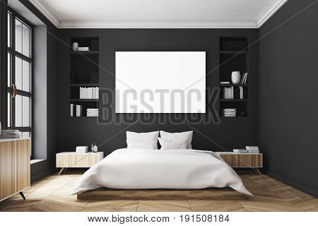 Interior of a modern luxury bedroom with black walls a large bed in the center of the room two bookcases by its sides a large window and a framed horizontal poster. 3d rendering mock up