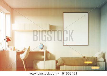 Front view of a kids room interior with a poster hanging above a bed bookshelves and a blue chair. White walls. 3d rendering mock up toned image